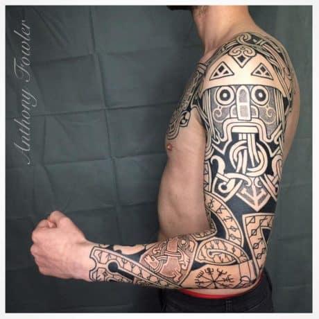 Black Celtic Tattoos in arm