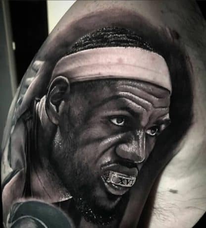 Portrait Style of Lebron James tattoo in arm