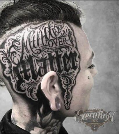 Script Style Lettering tattoo in head