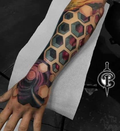 Abstract Style of Colorful Space tattoos in arm