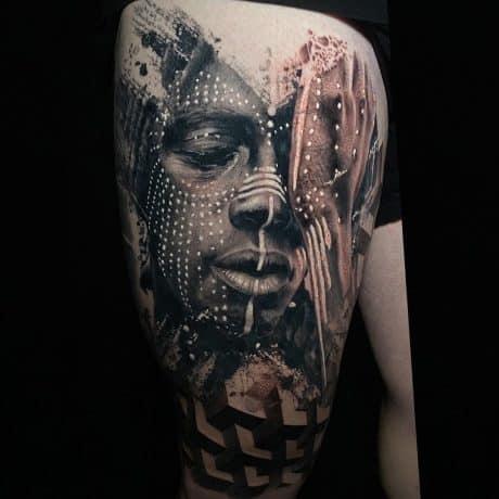black work tattoo in leg