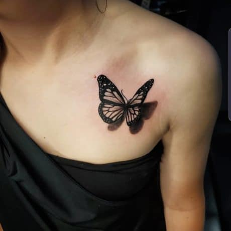 3D butterfly tattoo on chest