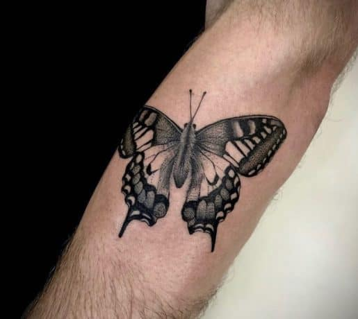 Black Butterfly tattoo on arm