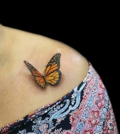 Orange 3D butterfly tattoo on chest