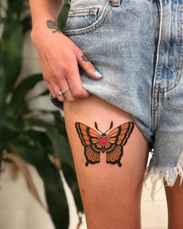Orange bold butterfly on leg