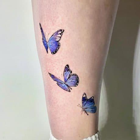 Purple butterflies tattoo on leg