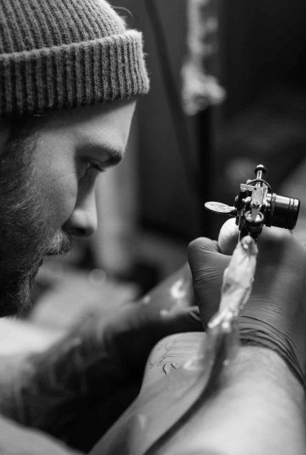Tattoo artist with tattoo